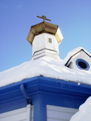 Directions to St. Nicholas Orthodox Church. St Nicholas Onion dome in front of a blue sky with a snowy roof.