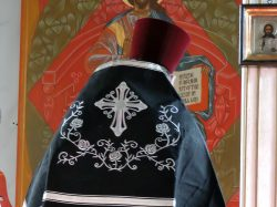 Priest in Black vestments serving