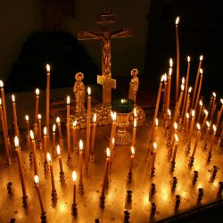 Panikhida tray with three bar cross and lit taper candles. Light a Candle, St. Nicholas Orthodox Church, Juneau
